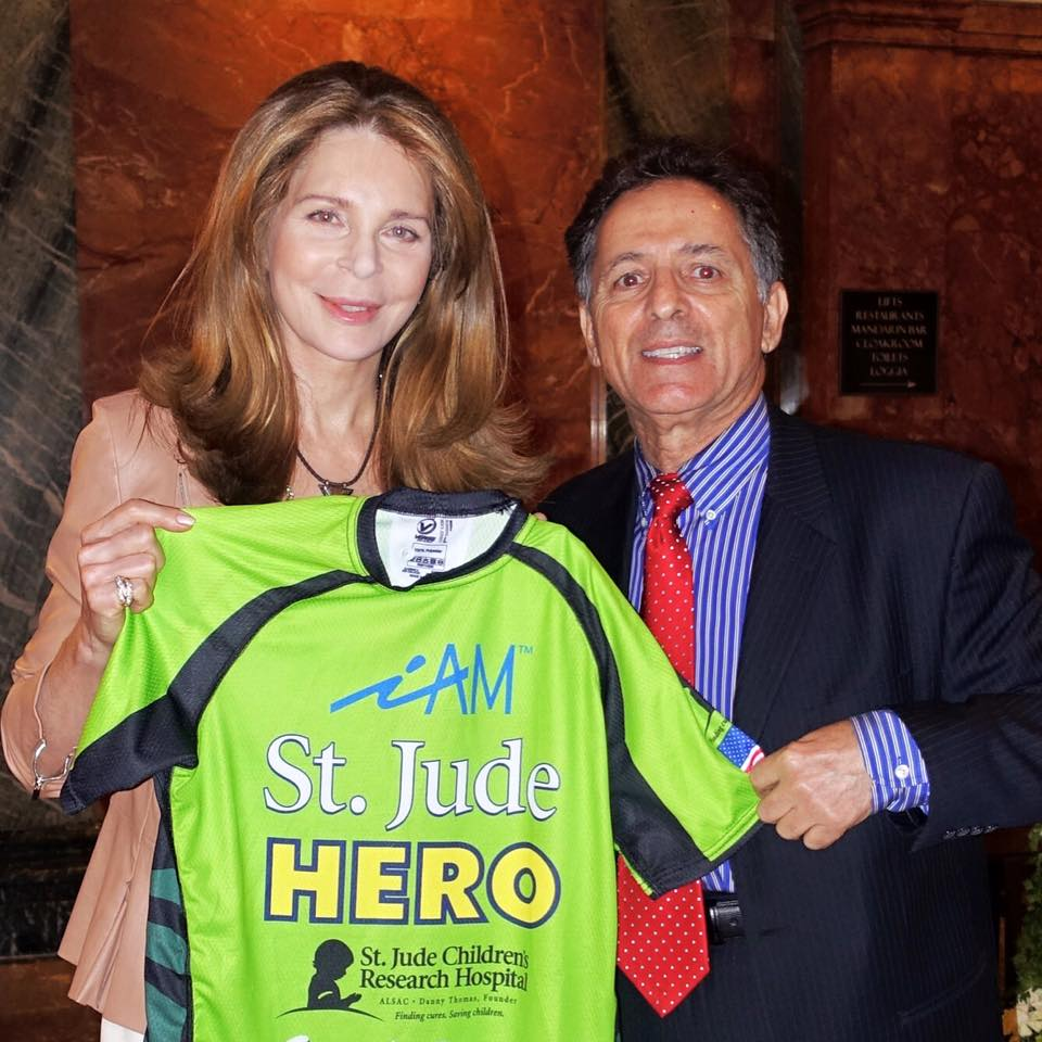 Queen Noor Al Hussein receiving an Honary iAM St. Jude Heroes Jersey from Chairman of the Anthony R. Abraham Foundation